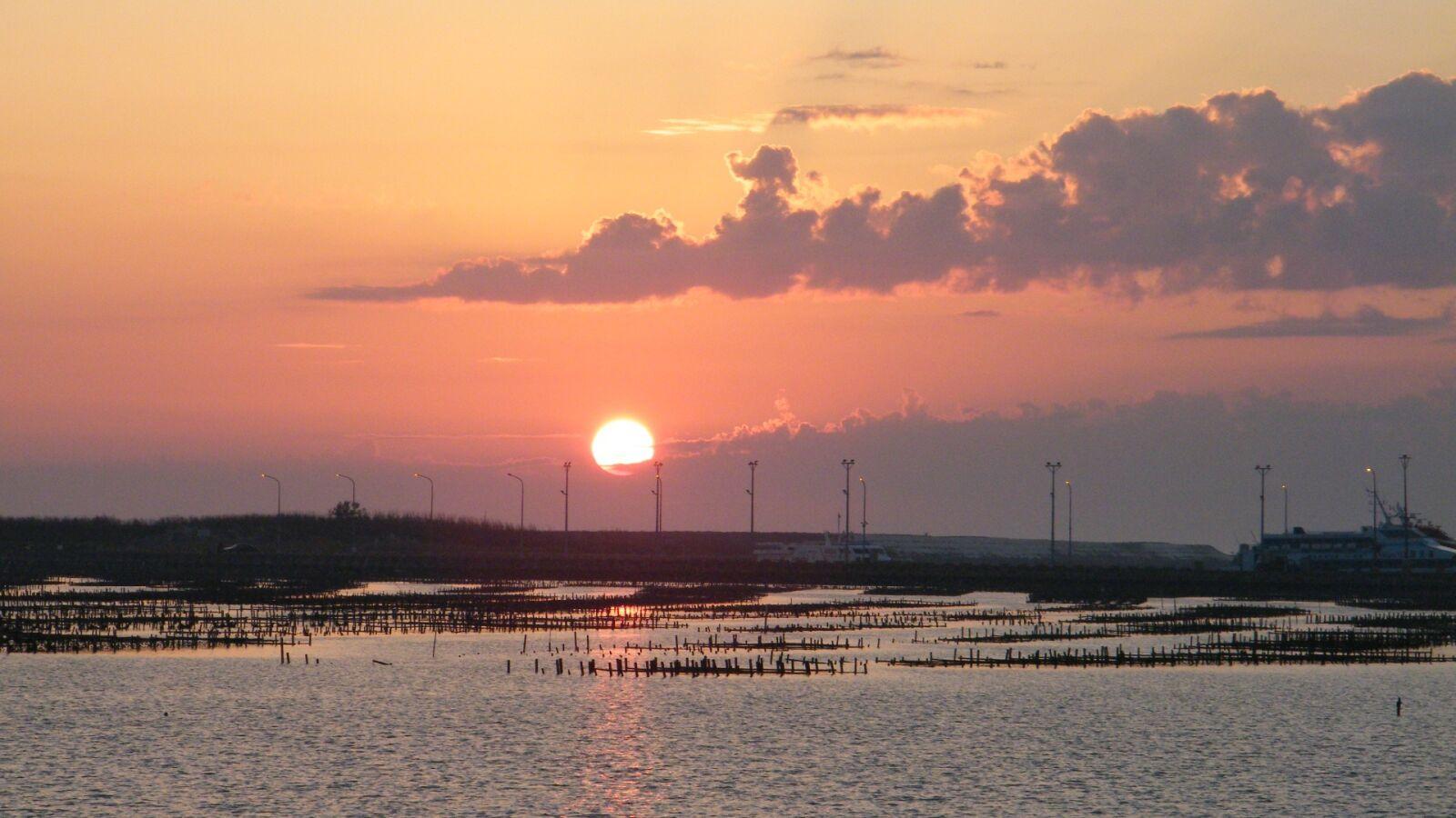"Fujifilm FinePix S2000HD sample photo. ""Sunset, the sea xi"" photography"