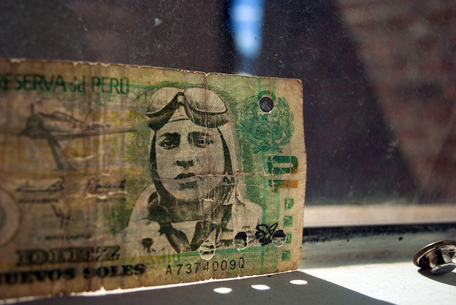 """Nikon D3000 sample photo. """"Money, coin, sol"""" photography"""