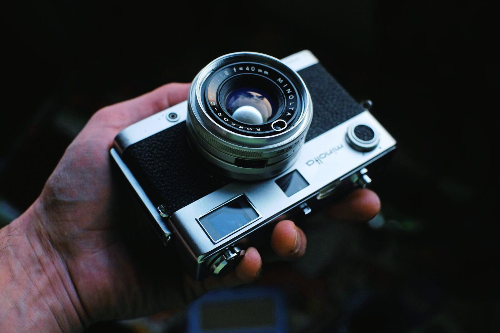 "Fujifilm X-E1 sample photo. ""Camera, hand, photographer"" photography"