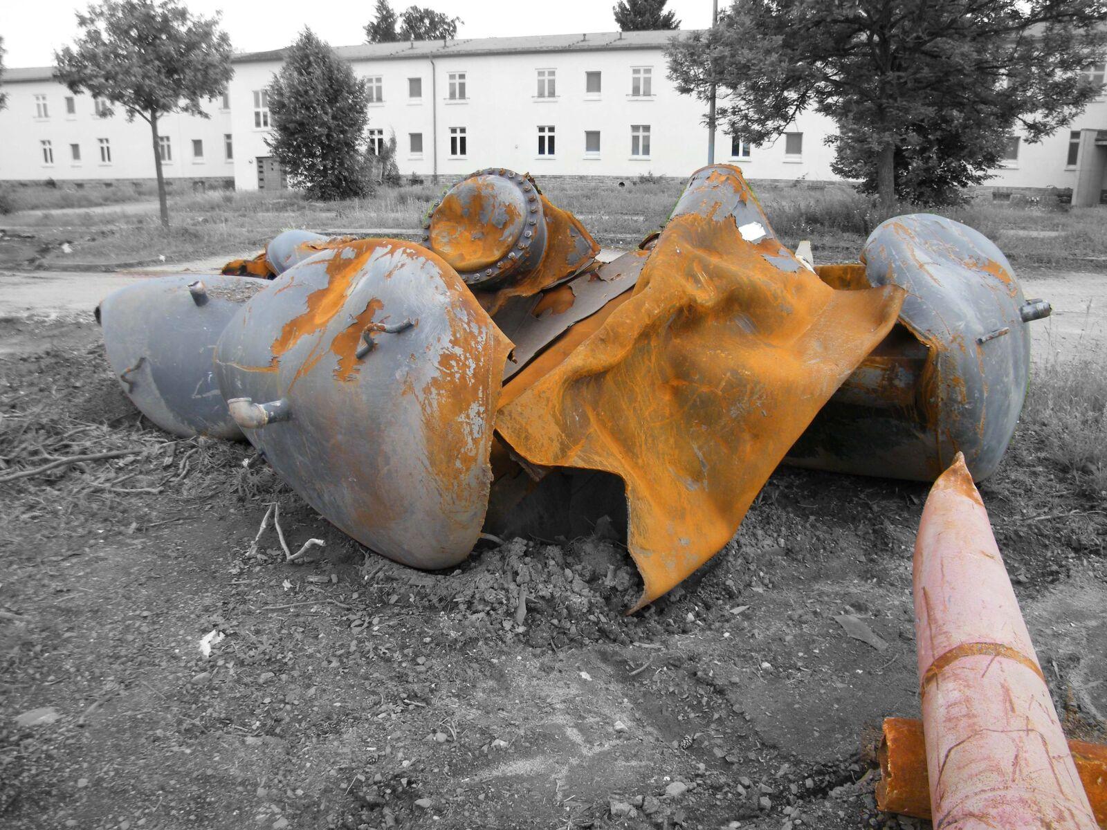 "Fujifilm FinePix S2000HD sample photo. ""Tank, demolition, rust"" photography"