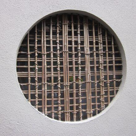 round window, mud wall, Canon IXY 200F