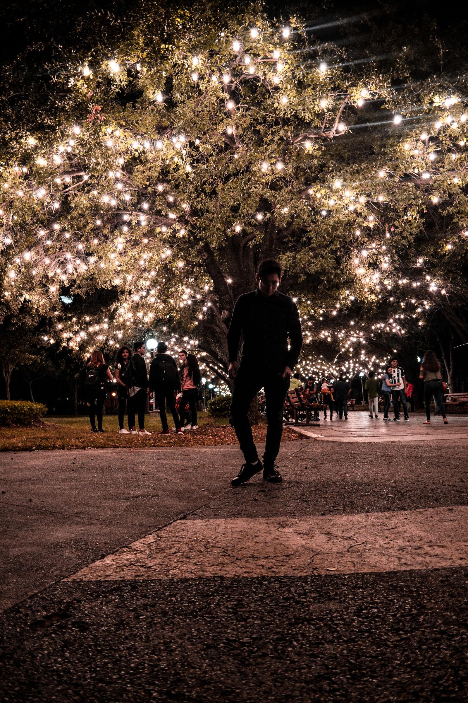 """Nikon D3100 sample photo. """"Diartob, lights, man, night"""" photography"""