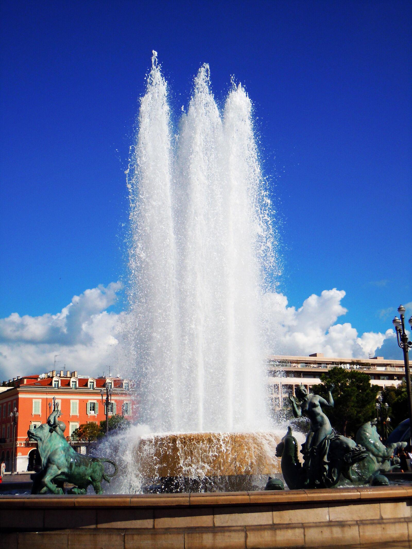 "Nikon Coolpix S8000 sample photo. ""Blue, sky, fountain, hot"" photography"