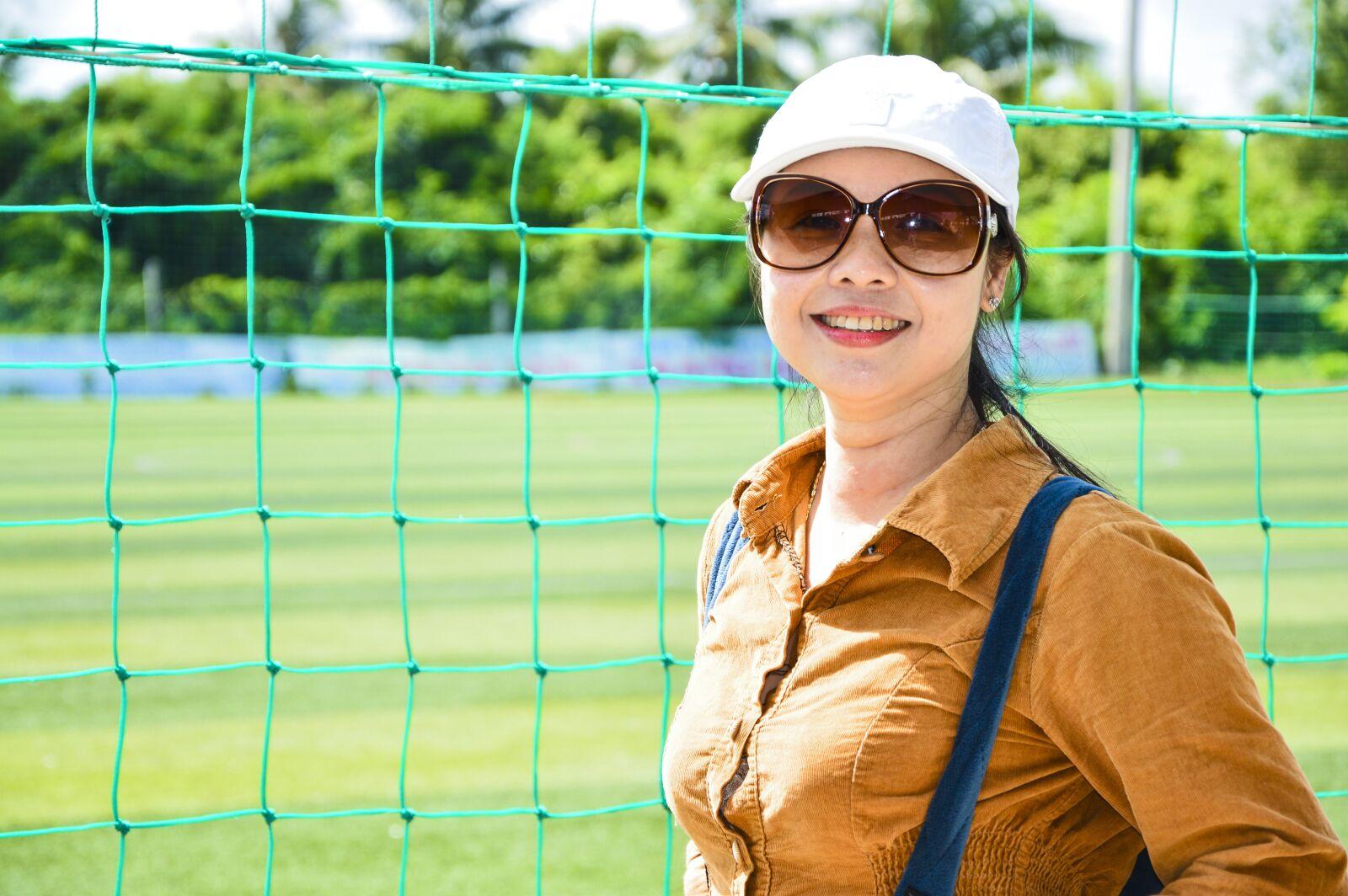 "Nikon D3200 sample photo. ""Beautiful girl, football pitches"" photography"