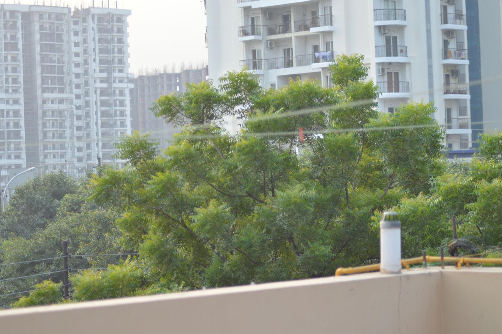 "Nikon D3200 sample photo. ""Apartment, building, greenery, trees"" photography"