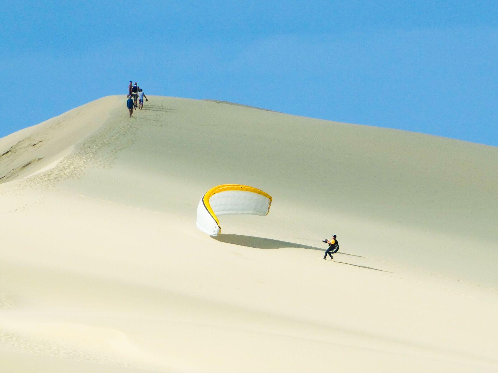 paragliding, sand, sky
