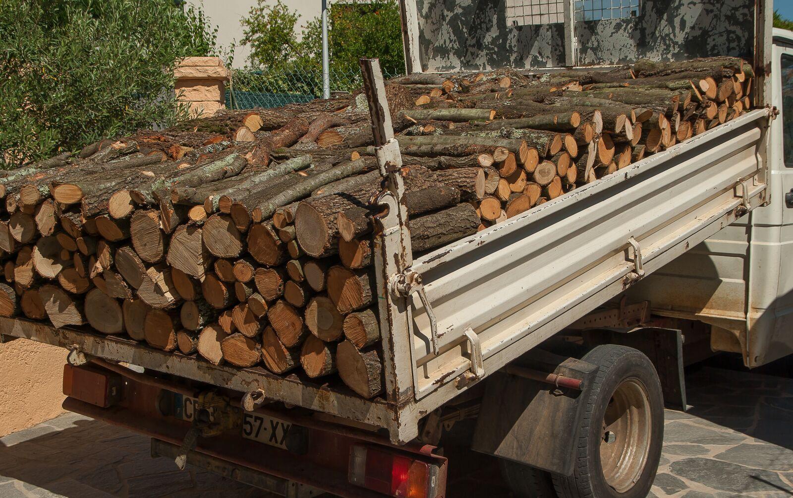 "Pentax K10D sample photo. ""Wood, logs, truck"" photography"