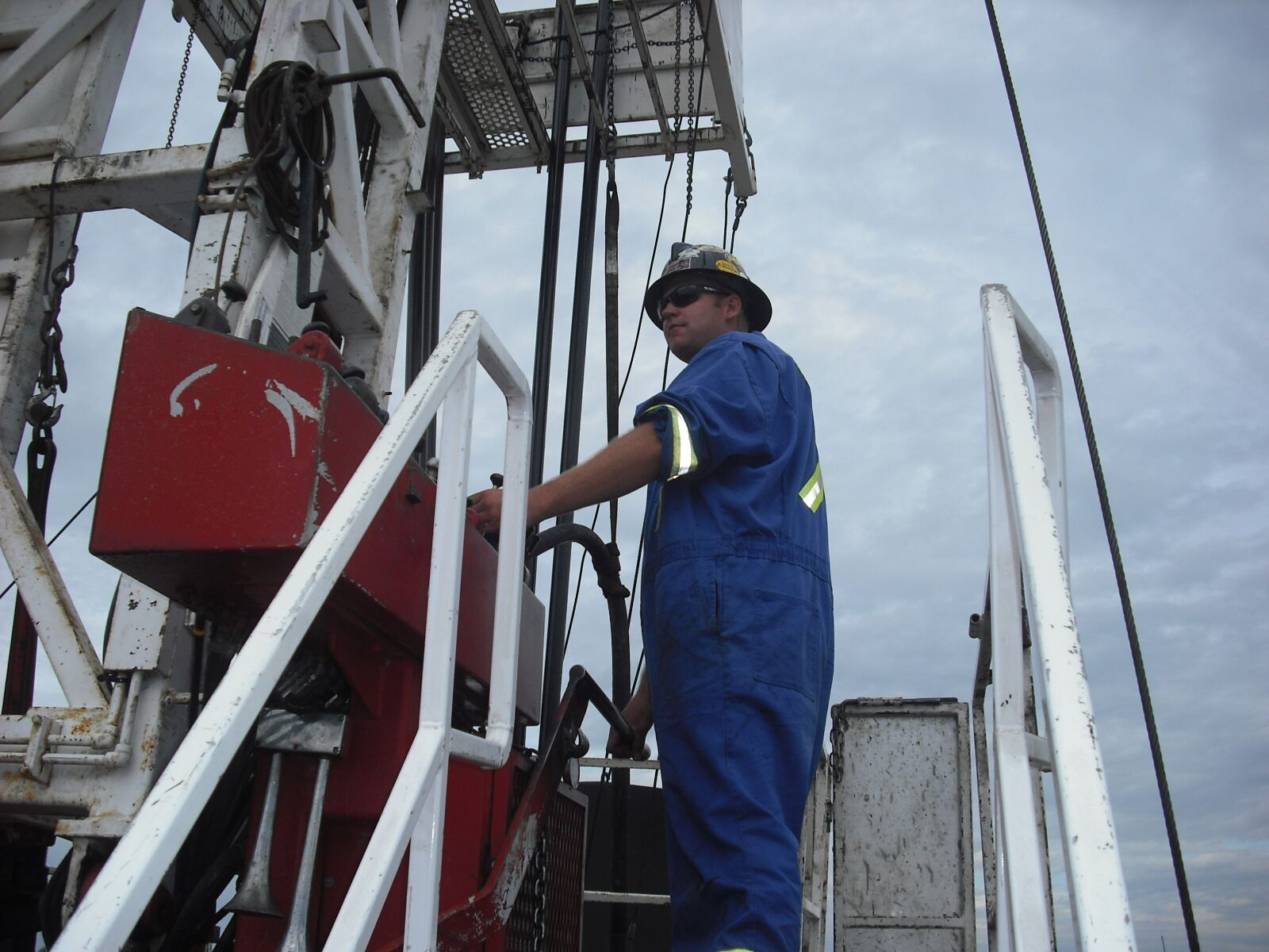 driller, service rig, oil