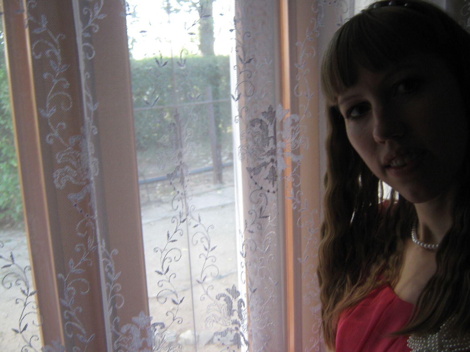 "Canon PowerShot A470 sample photo. ""Girl, window, thoughtful"" photography"