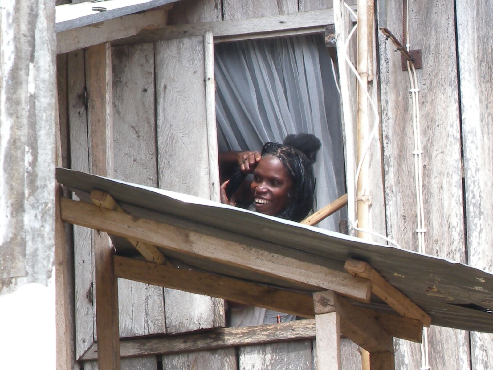 african woman, woman window