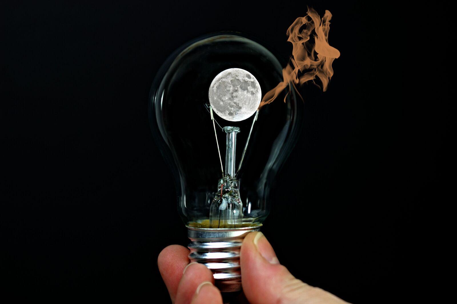 light bulb, hand, moon